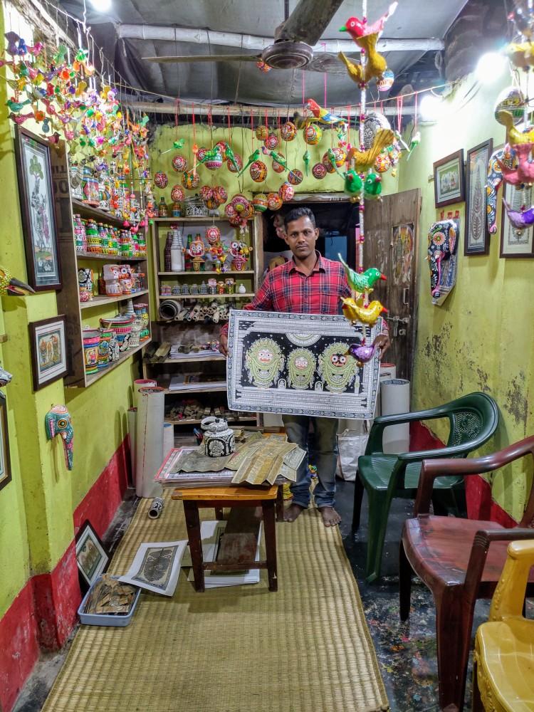 Kanu from Dasbhuja handicraft as Raghurajpur heritage village in Odisha showing his Pattachitra craft
